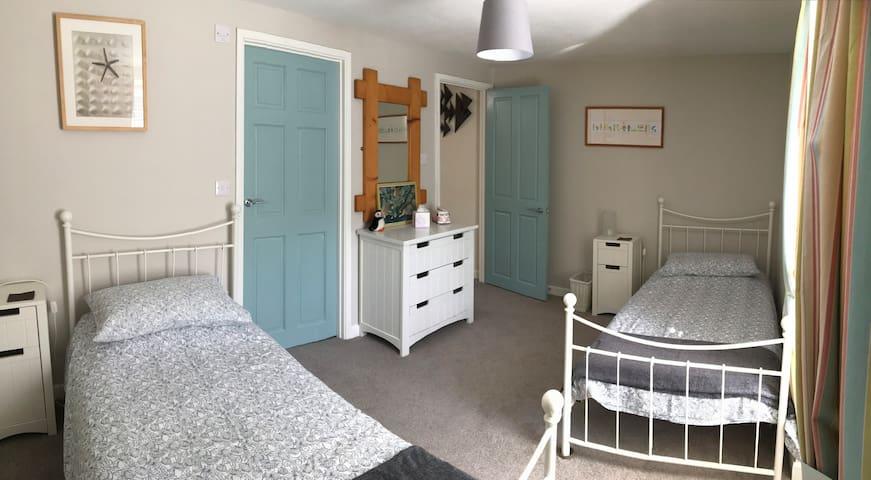 Good size twin room with en suite bathroom.