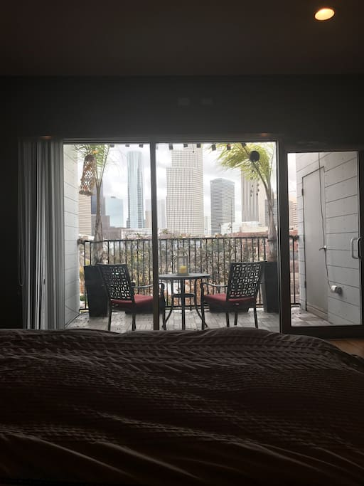 View from the bed with curtains open