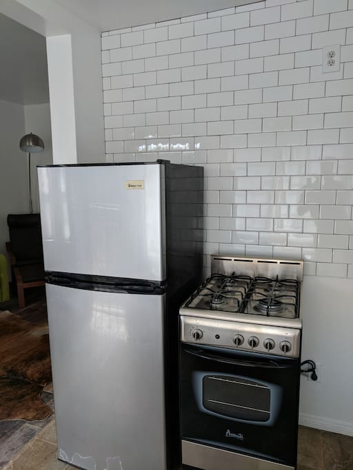 Small stainless steel Fridge and oven