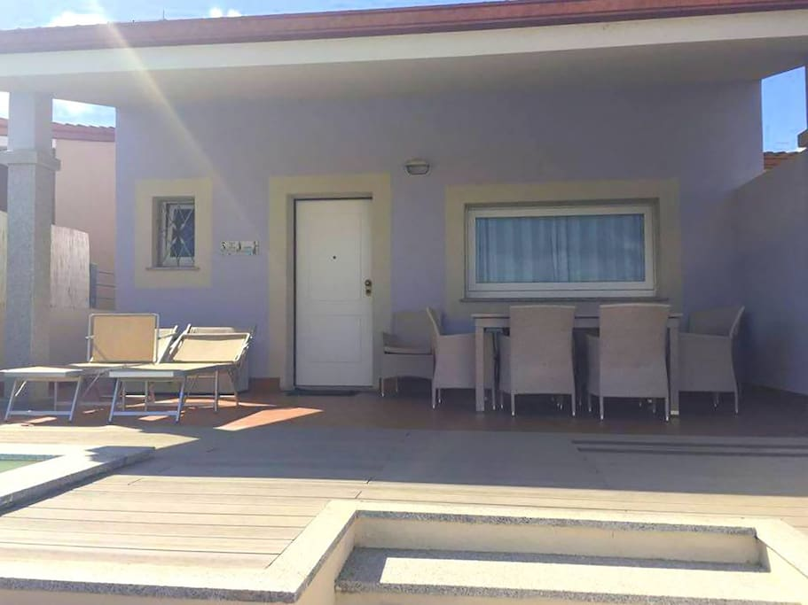 Outdoor dining area and sun loungers