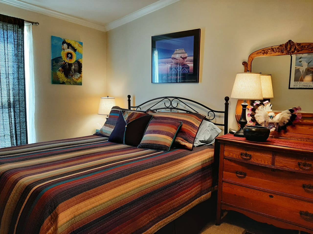 Queen bed with memory foam topper, electric blanket, antique dresser and local Art!