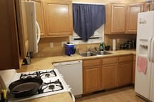 Shared full size kitchen that is readily accessible for use.
