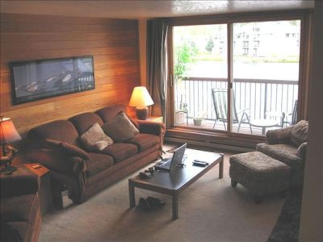Cozy living area with fireplace with deck overlooking Keystone Lake