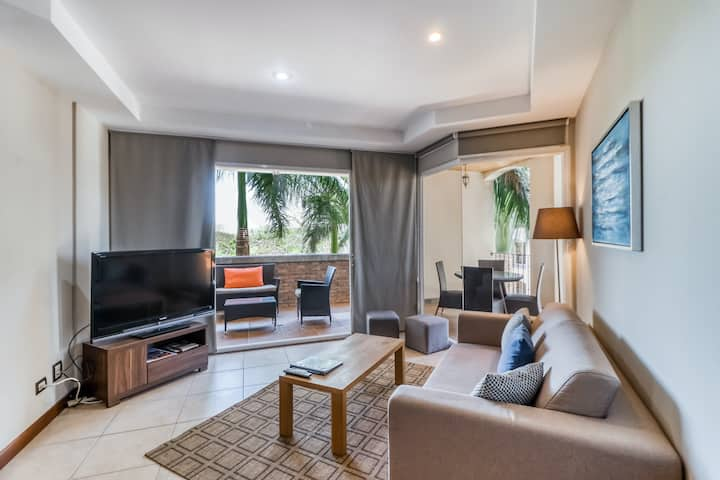 Modern condo in Playa Langosta w/shaded terrace & jetted tub -steps to the beach