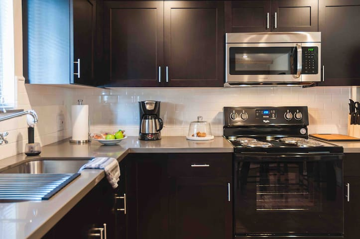 Beautiful custom modern kitchen. All of your pots and pans and dishes you will need during your stay. Spices, coffee and breakfast items are all provided.