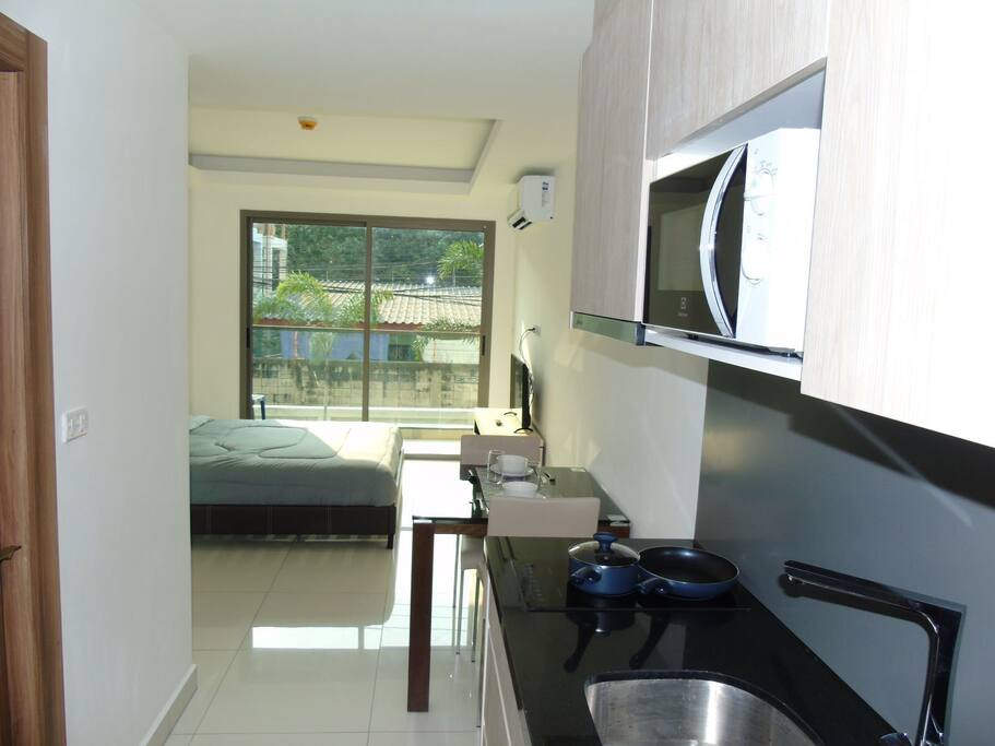 Small kitchen with microwave and 2 ring cooking hob