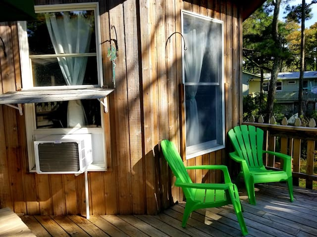 Adirondack chairs overlooking backyard