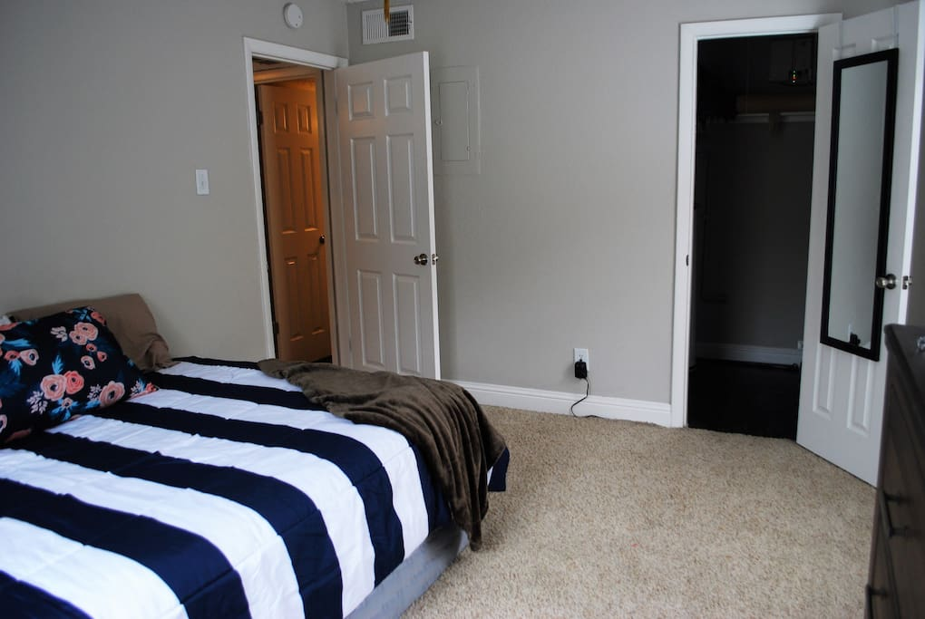 Bedroom 1 with walk in closet and large TV