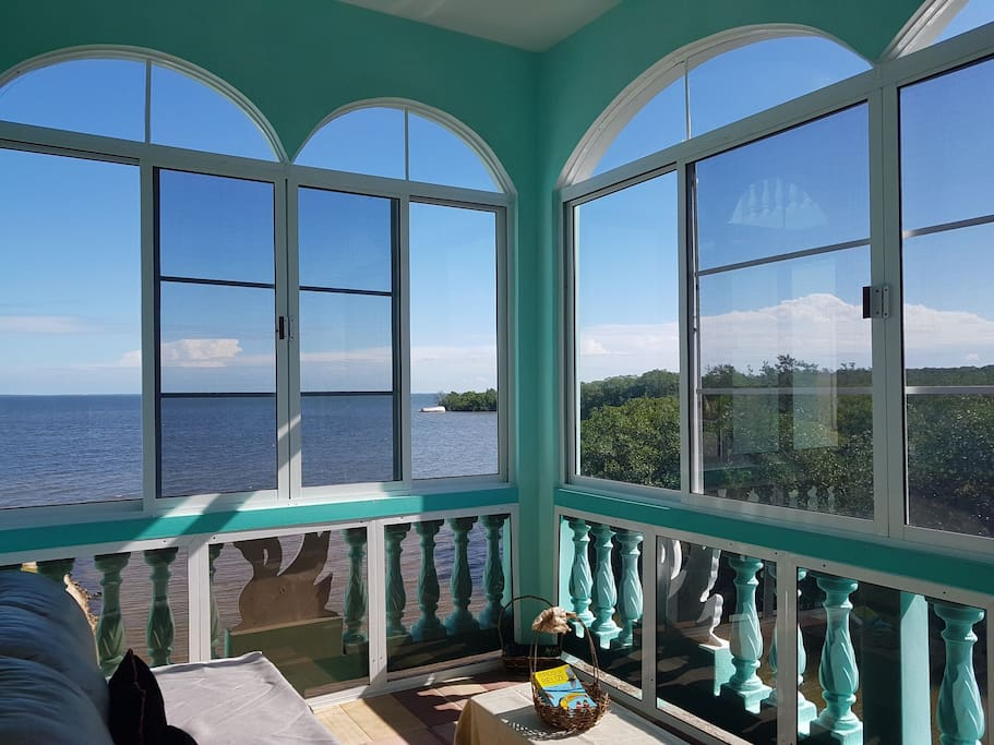 Breathtaking view of the Caribbean Sea from the comfort of your very own Sunroom!