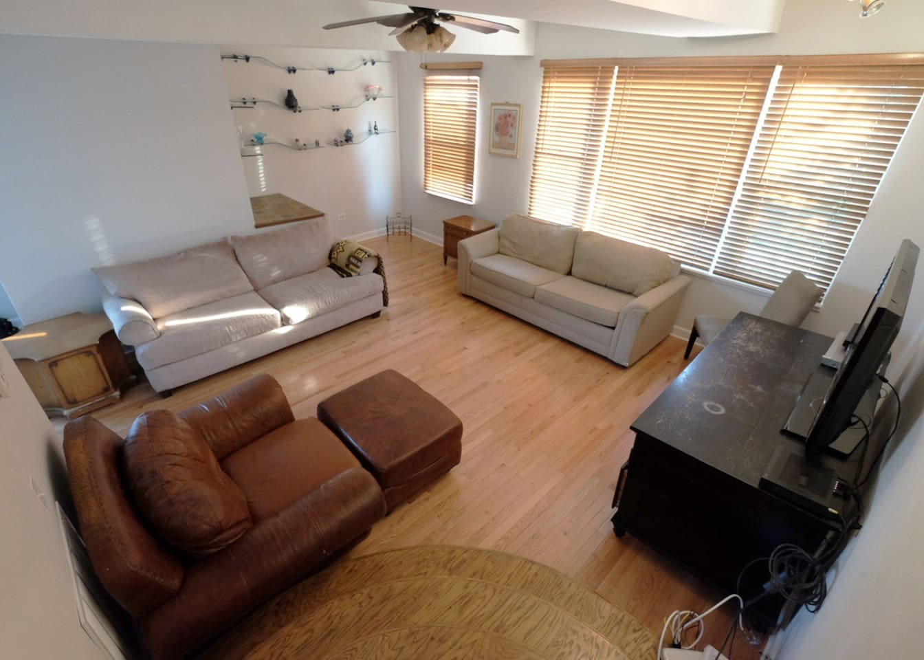 Roomy living room with entrance to front balcony