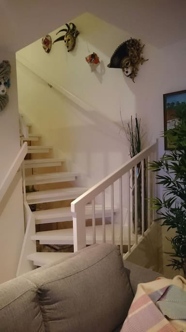 Stairs to the first floor with two bedrooms and bathroom