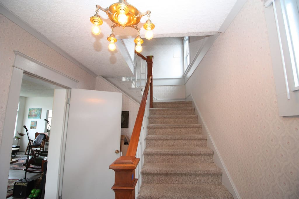 Stairs leading to upstairs bedroom.