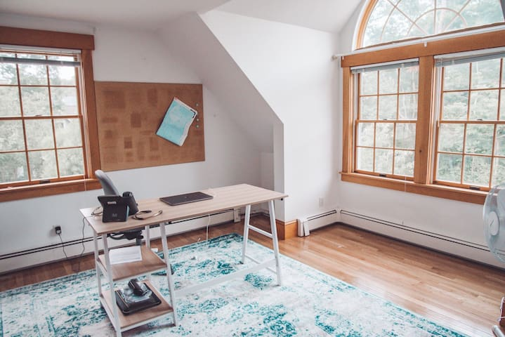 office - has desk/office space as well as a queen bed and closet