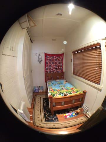 Kids bedroom 1 - single bed & built-in robes