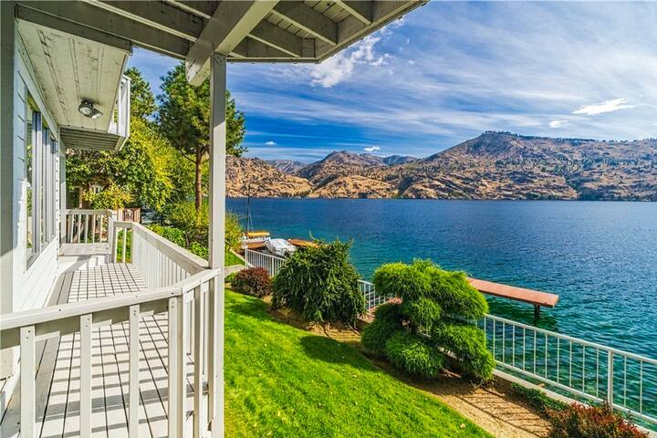 Lakefront home w/ stunning views, three decks, waterfront patio, & dock!