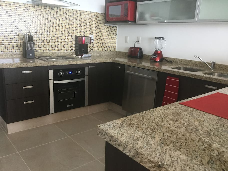 Large, functional kitchen with all amenities needed to cook.