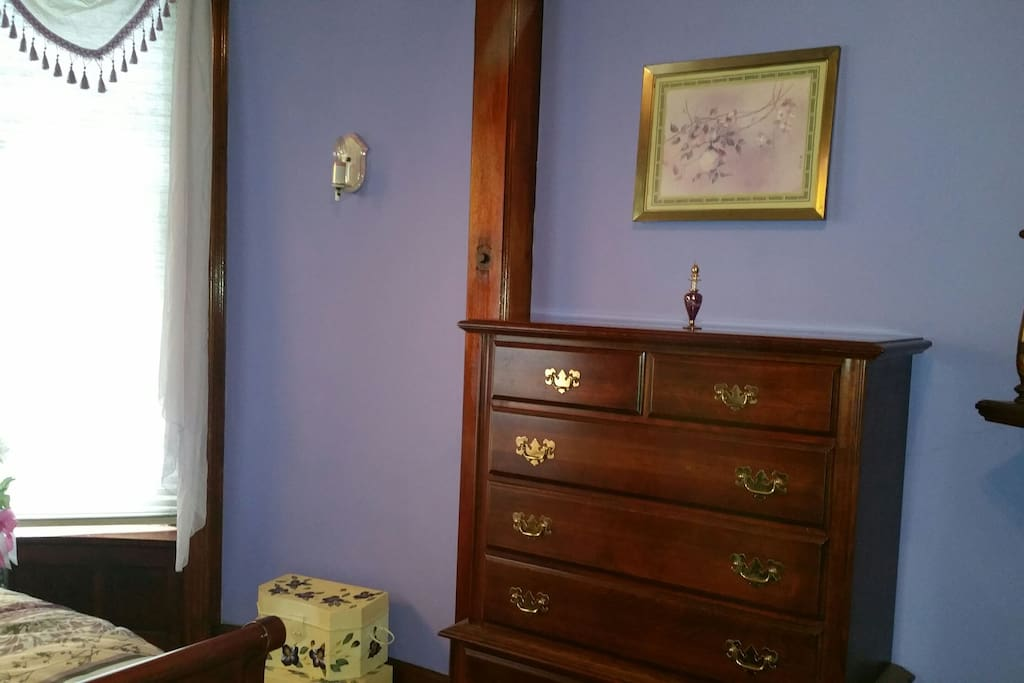 Tall dresser to the right of the bedroom.