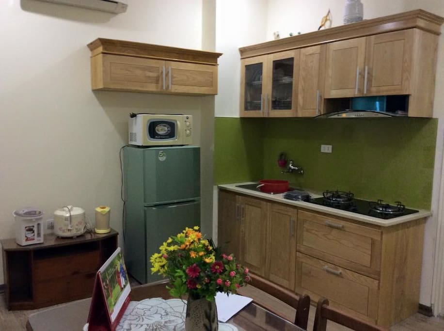 Kitchen with rice cooker and other cooking utensil