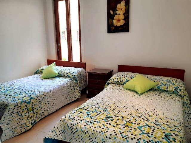 Alcoba camas semidobles