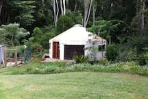 Sofia Yurt surrounded by the rainforest and veggie garden. Large window can be easily rolled down for more privacy.