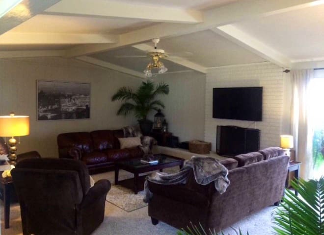 Living Room #1 has seating for 8. Watch a movie or enjoy the beautiful view of the back yard  from one of the comfy recliners, and kids can enjoy our  Fun Chest with plenty of room to play the toys and games  provided for them