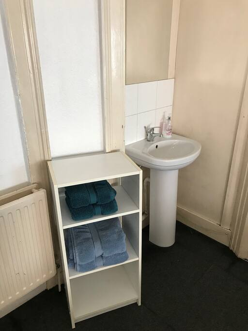 The room has a sink and towels provided.