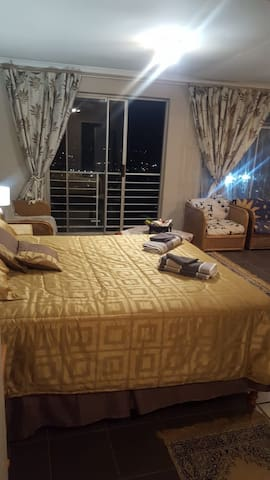 2 double beds in a self- contained apartment with spectacular views