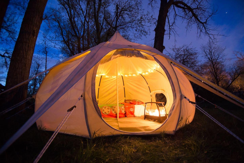 The yurt lit up at night!