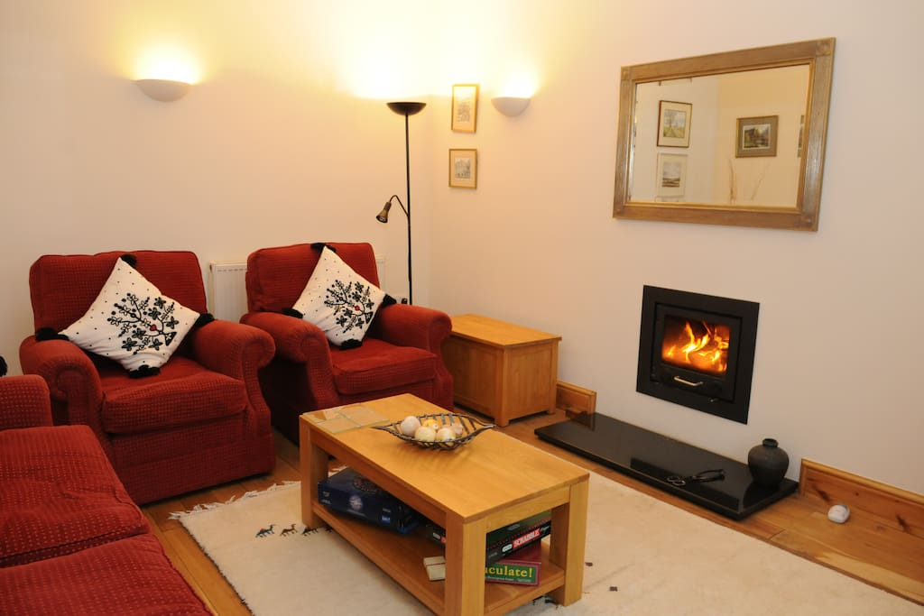 lounge with log burner for exclusive guest use