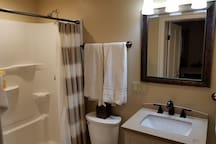 Large shower and fresh towels weekly. Bathroom includes a makeup mirror and hair dryer.
