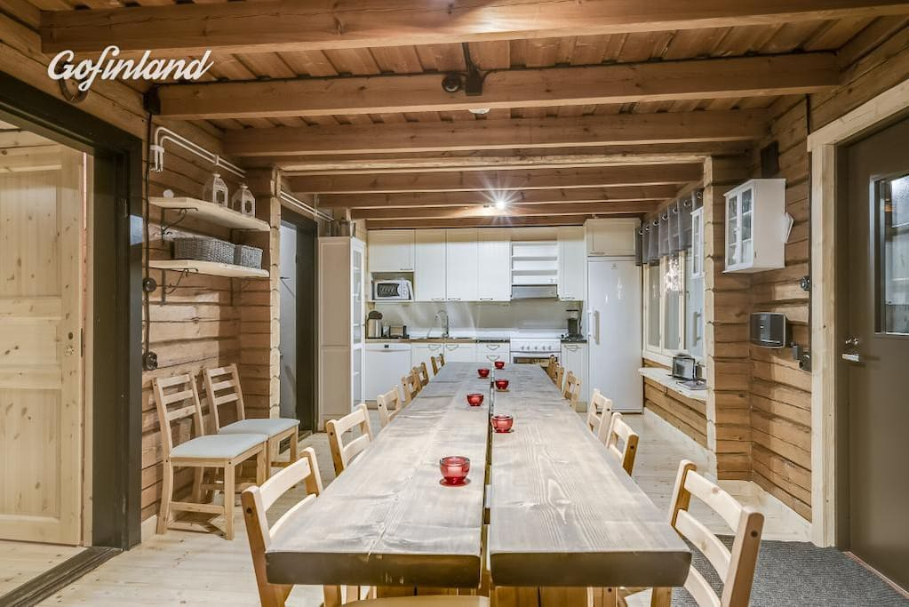 Open kitchen with the long table for up to 18 persons. Imagine this 60 years ago before the renovation. No light, no electricity no running water... Just those hard working lumber jacks!