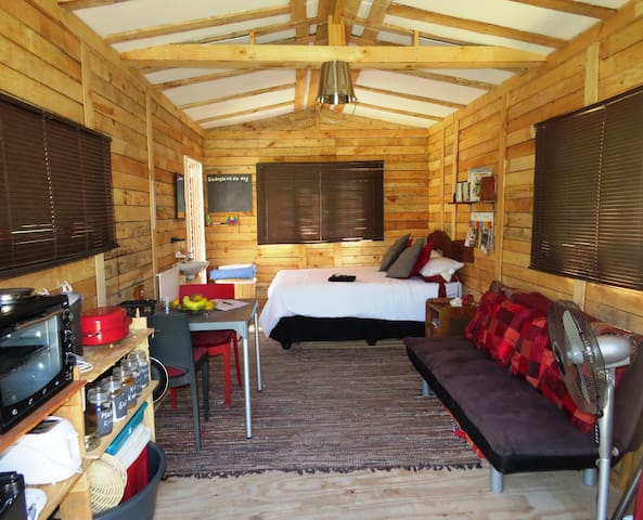 Cabin with double bed , electric blanket, basin, microwave, fridge, kettle, oven, joined to terrace with pizza oven and braai area