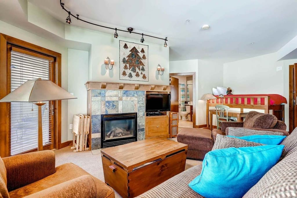 Living Room w Pull Out Queen Sofa Sleeper  / Gas fireplace / HDTV/ Private Balcony