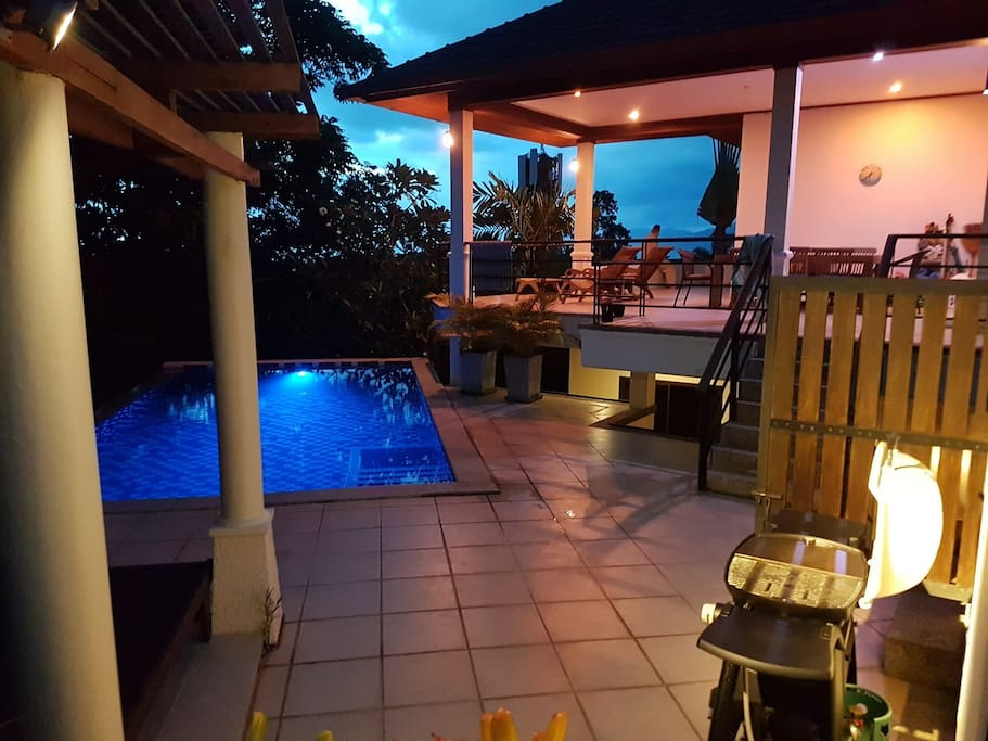 Pool terrace at night (shared area).    You can see the top level in the background - that's where the owners live.