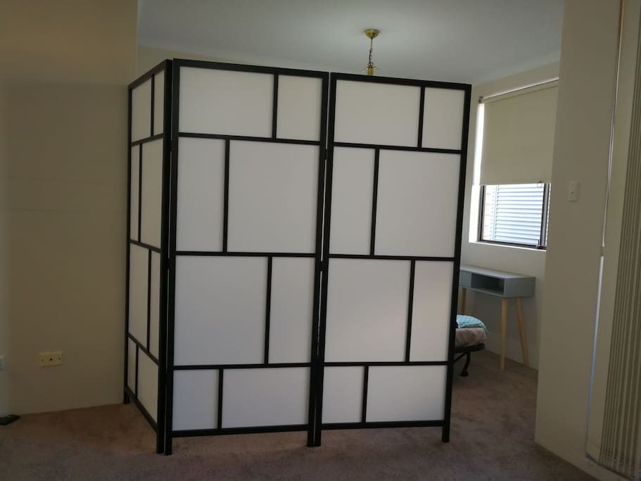 A room divider for your privacy, it can close the entrance gap completely. Our bedroom is upstair so at night the whole first floor is yours :)