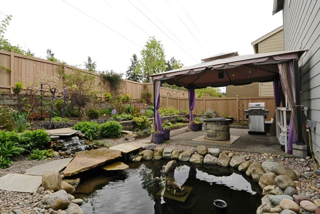 Swing, Barbeque grill, Fireplace, Gazebo and Water Feature in backyard