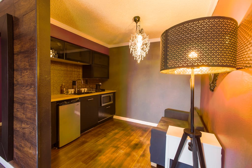 Vaudeville lighting, kitchen with microwave, mini-fridge and k-cup coffee maker.  Convertible sofa-bed.