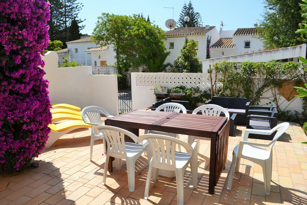 Patio with BBQ loungers, sofas,dining table+chairs