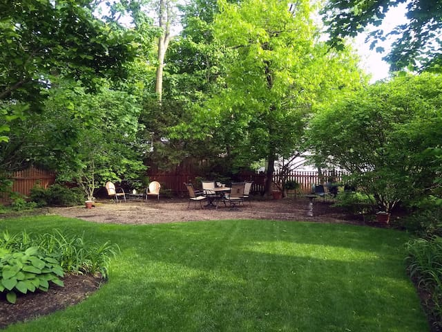You may choose any one of three different seating areas in our private back yard.