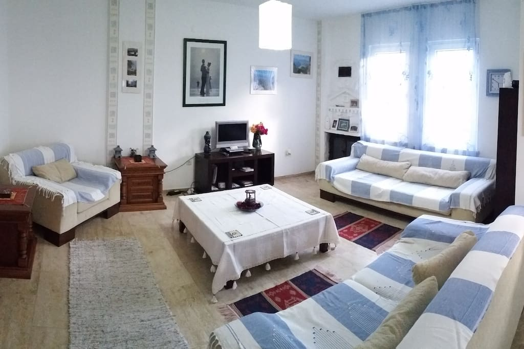 Living Room with Smart Large Screen TV, with  DVD player and AC