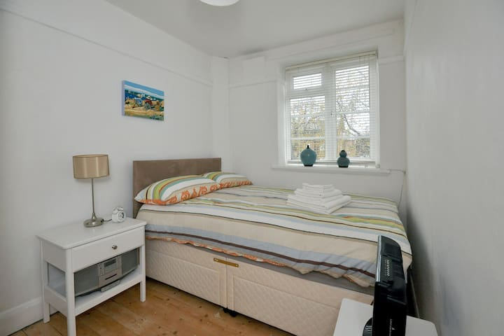 Queen size bed, orthopedic mattress, stripped wooden floors and TV