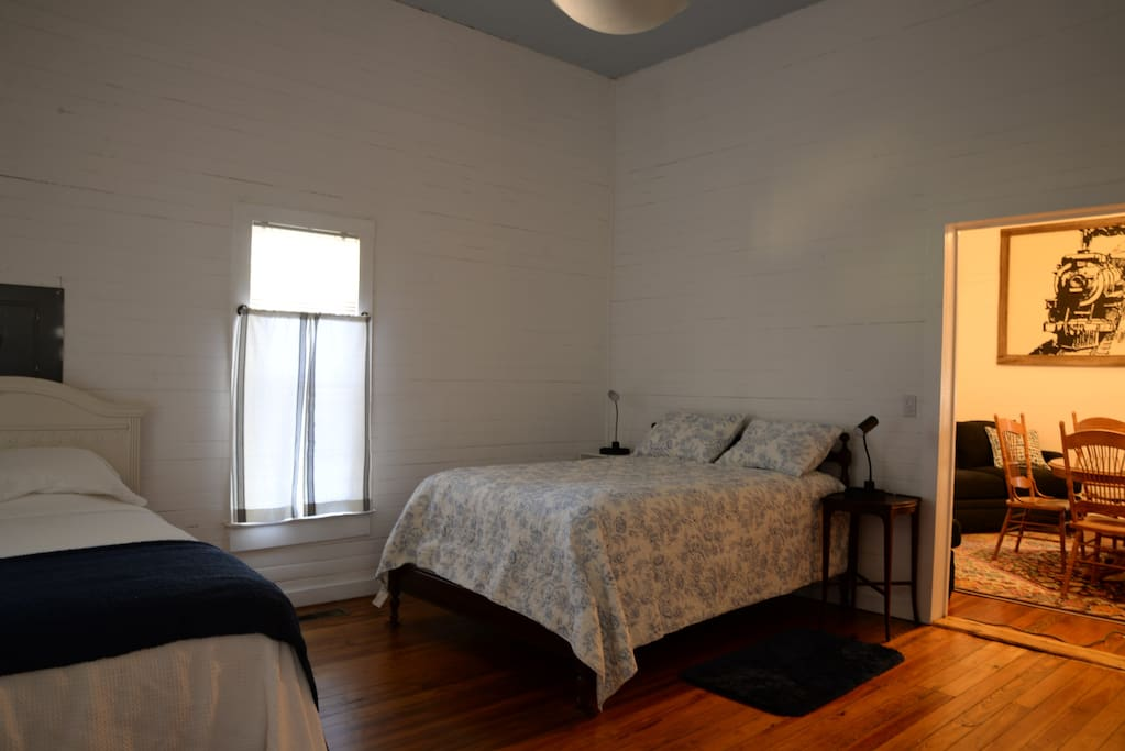 Bedroom with full and twin beds.
