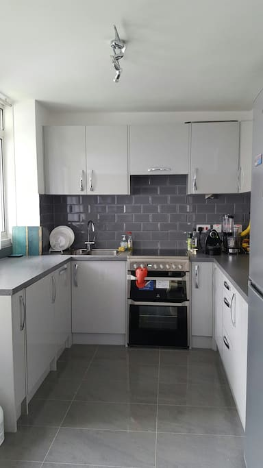 Open plan Kitchen with all key appliances including cooker, washing machine, dishwasher. fridge/freezer