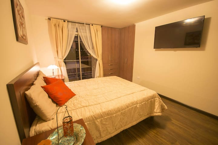 BALCONY BEDROOM: Light & spacious room, it includes a private balcony, queen bed, modern bathroom, closet and satellite TV.