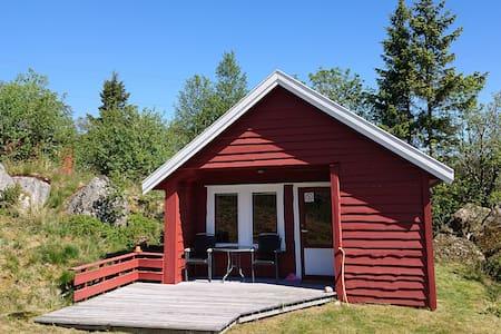 Koselig hytte i naturskjønne omgivelser