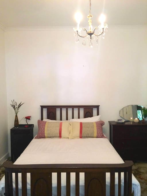 Queen size, comfy antique bed and chest of drawers.