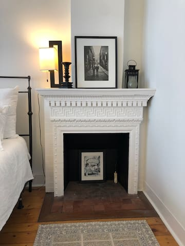 The Birch Room has a wonderful decorative fireplace with ceramic inlays.