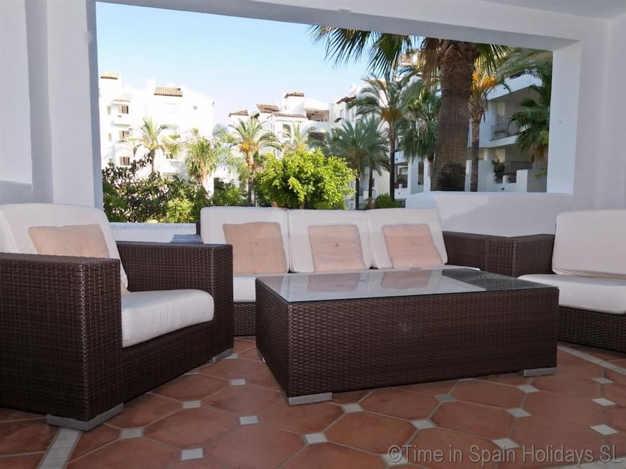 Modern furniture on covered terrace