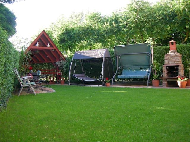 Garden with bbq, trampoline and hammock