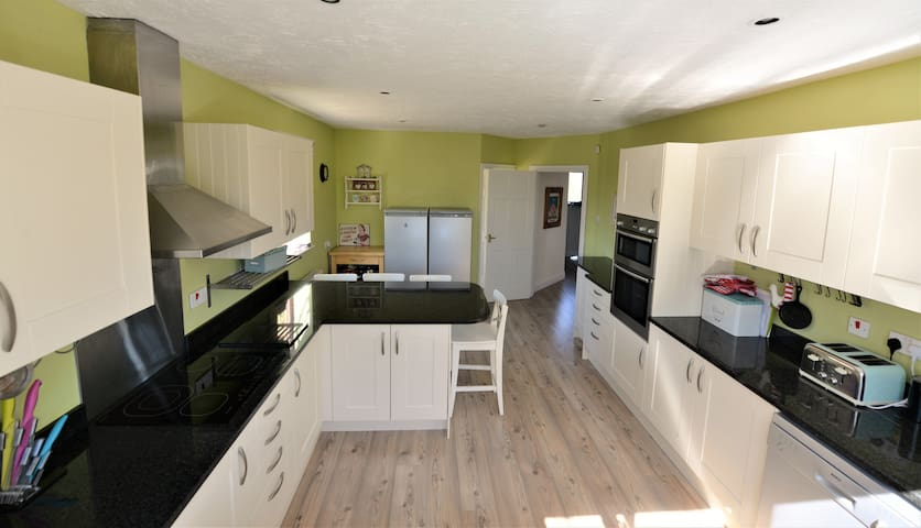 Full range of cookware, pots, pans etc. Access to Utility room with ironing facilities, washing machine and dryer, plus additional sink.